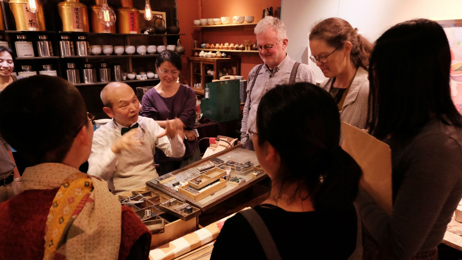 Wai-te-ata team enjoy a typesetting demostration by Mr. Wu of Letterpress Teahouse