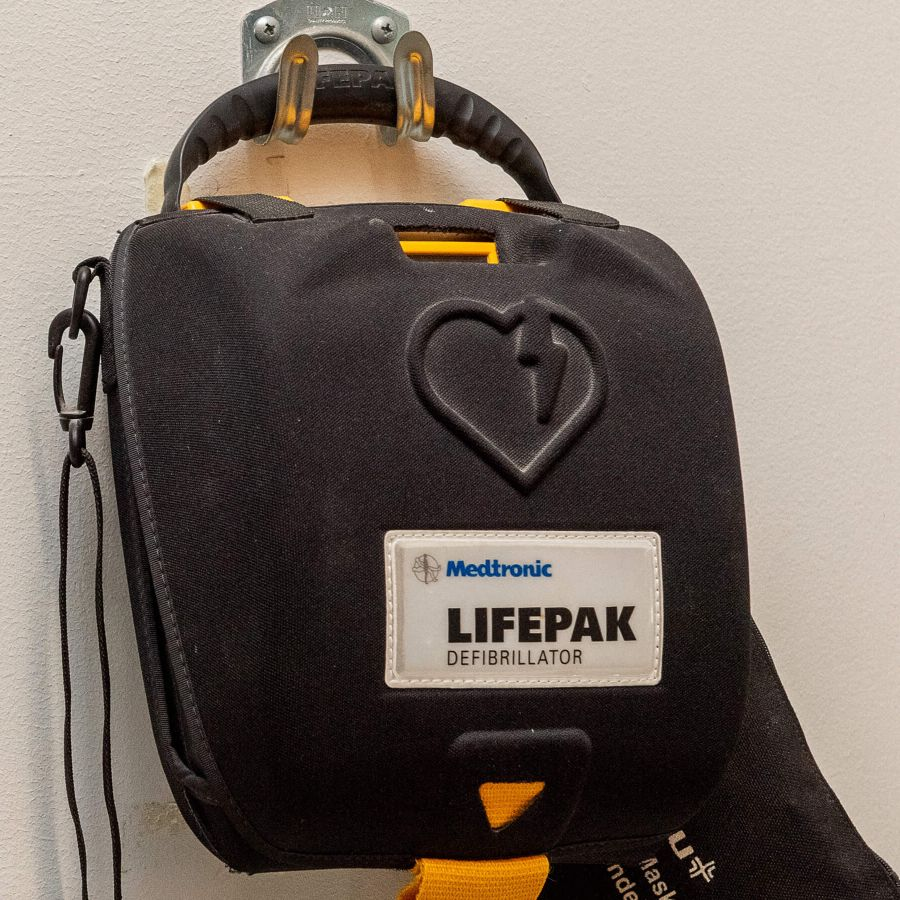 Automatic External Defibrillator or AED mounted on a wall