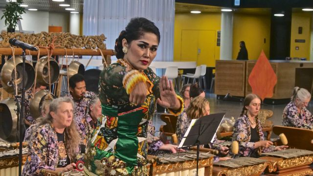 Dancer with gamelan ensemble