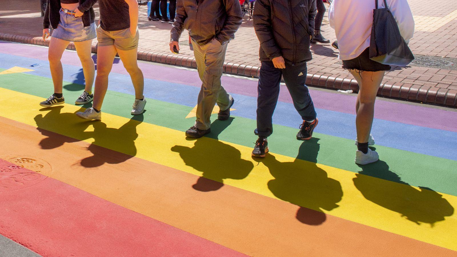 Students walking across Rainbow crossing on Cuba Street