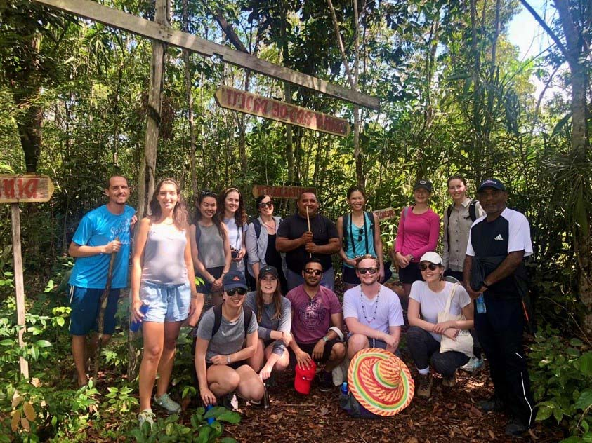 Students pose for photo in the Amazon