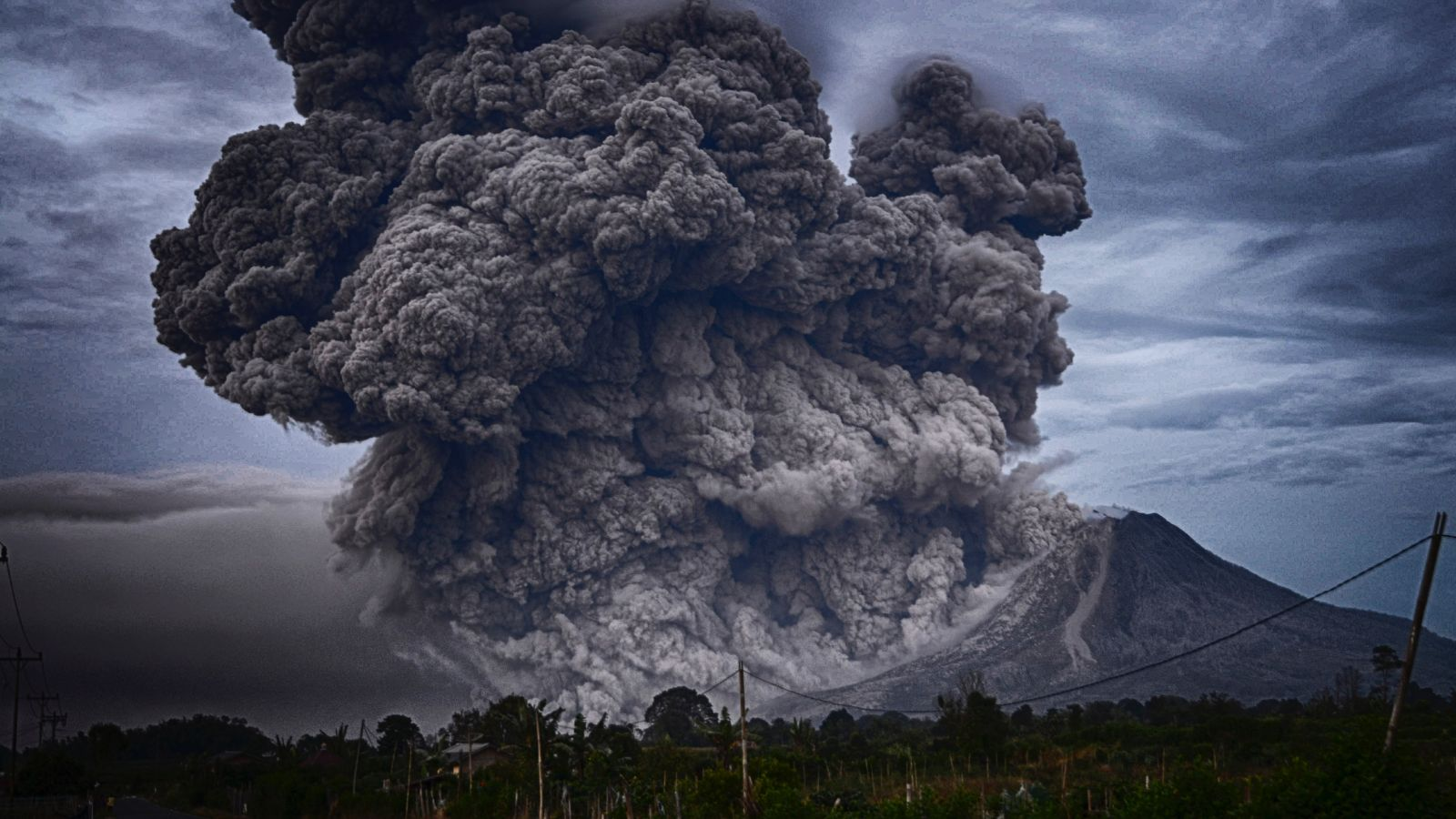 Massive billowing clouds from an eruption of Mt Sinabung, Indonesia. Photo: Yosh Ginsu, Unsplash.