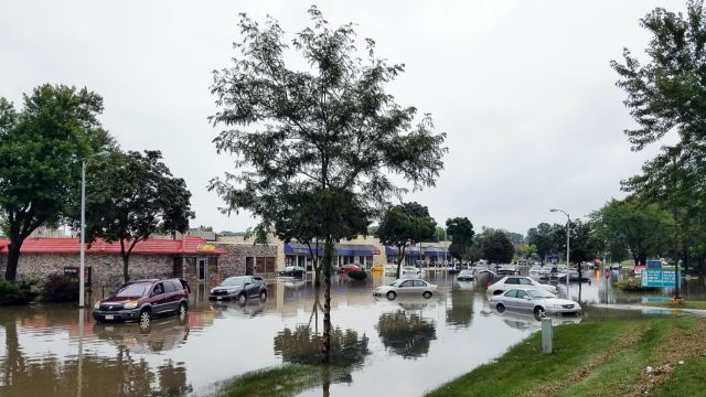 An image of a flooded roadway with stranded cars.