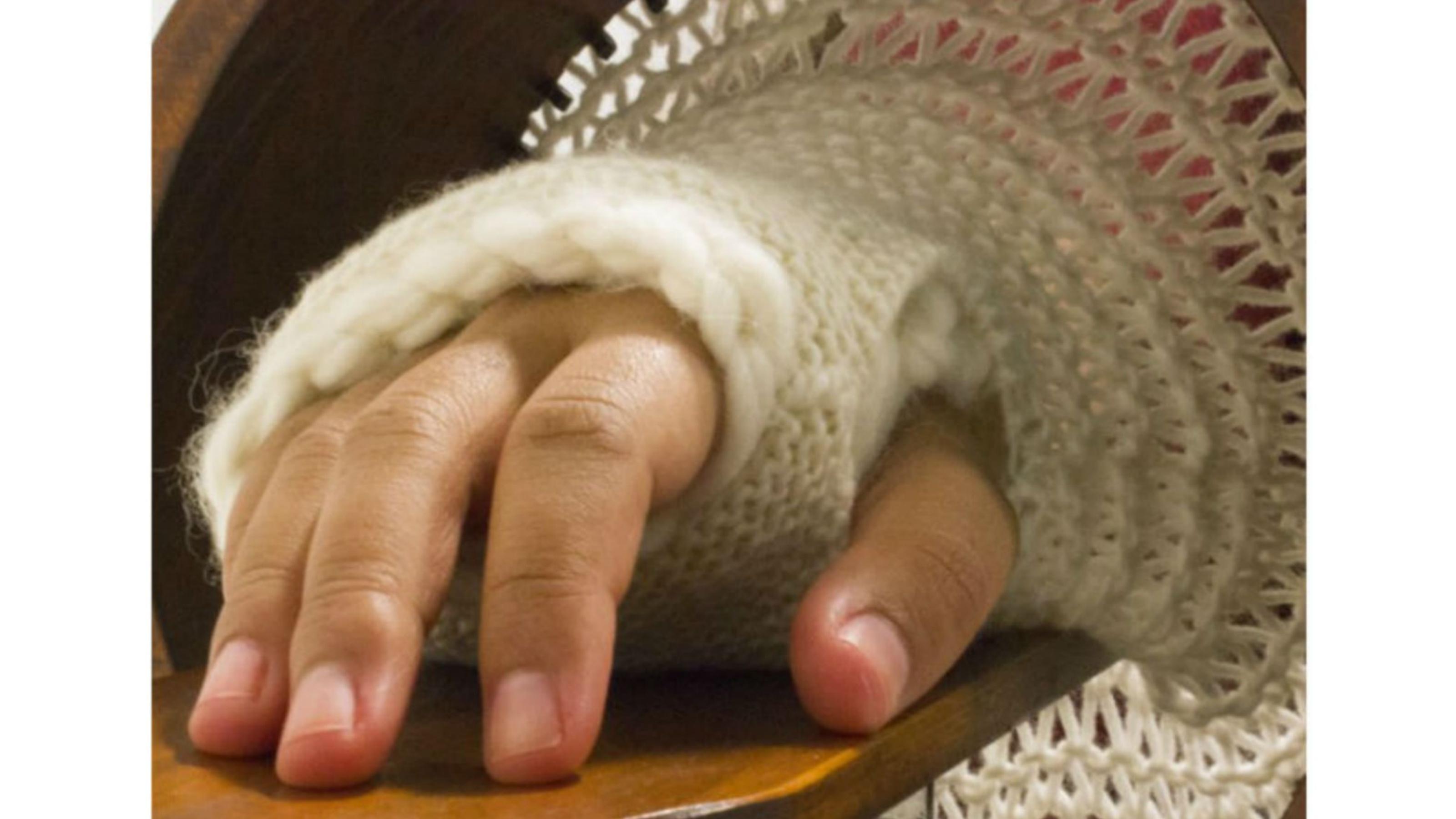 Hand in woven glove