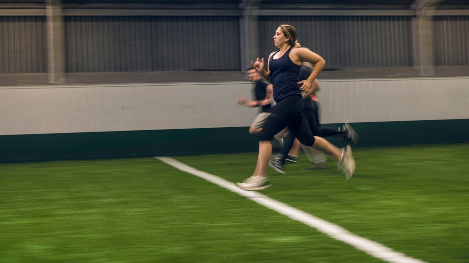 Students sprinting through the Boyd-Wilson arena.