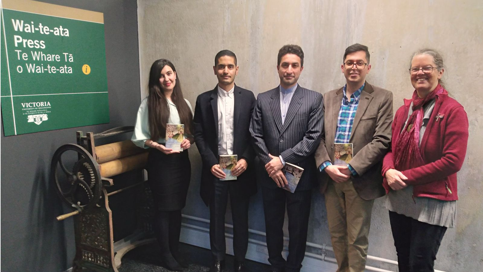 Translators Nastaran Arjomandi, Mohsen Kafi, and Fahim Afarinsadi with Mr Shamsollah Azimi and Associate Professor Sydney Shep outside Wai-te-ata Press.