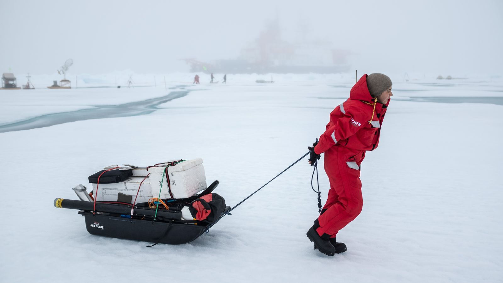 Ruzica Dadic pulling the sled of equipment in the Arctic