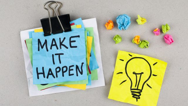 Image of post-it notes with with writing saying Make it happen