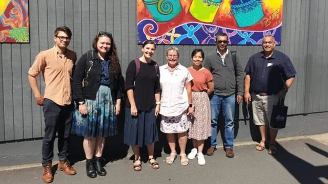 From left to right: Finn Illsley-Kemp (Victoria University of Wellington), El Mestel (Victoria University of Wellington), Lucy Kaiser (GNS Science/Massey University), Annemarie Hyde (Deputy Vice Principal of Mokoia Intermediate School), Marion Tan (Massey University), Raj Prasanna (Massey University), Kelvin Tapuke (University of Canterbury).