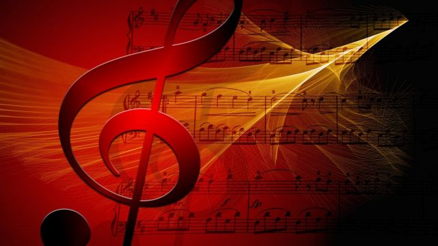 Large treble clef, sunburst colour red to black emanating from centre, superimposed over three lines of music score. Background colour is sunburst black to red, from right to left, with yellow-gold glowing fractal flame pattern growing out of the black, sweeping across the red.