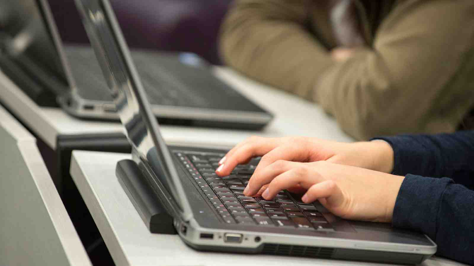 Student working on their laptop