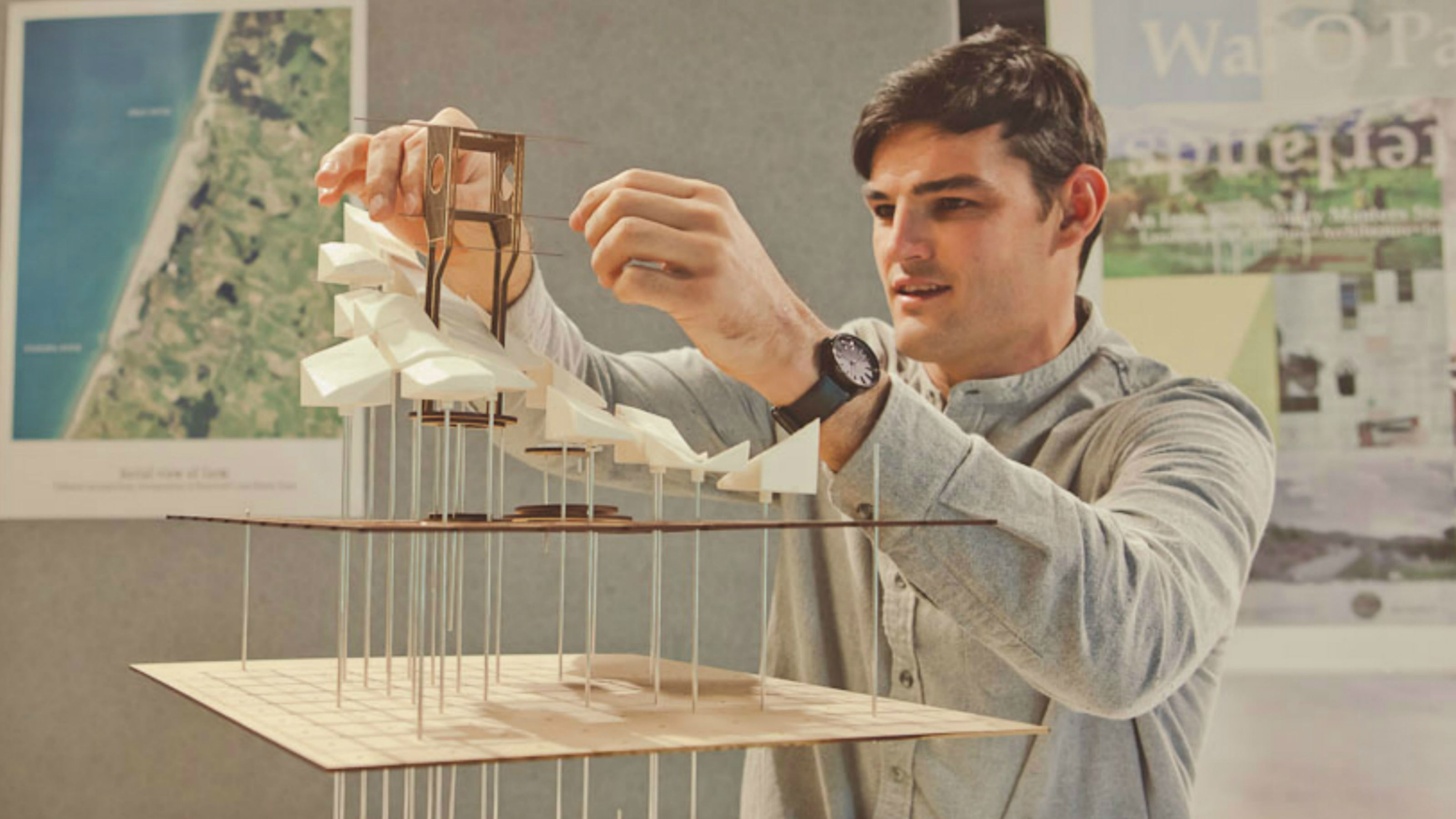 Student Devon Booth assembling a model for his fourth year architecture studies.