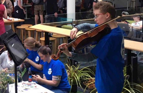 Te Kōkī New Zealand School of Music student Georgia Steel plays the viola at a Victoria celebration for Mental Health Awareness Week.