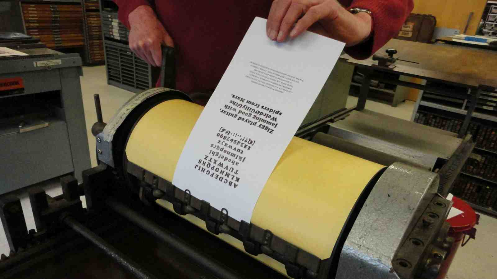 David Naull's pulls a print of a type specimen.