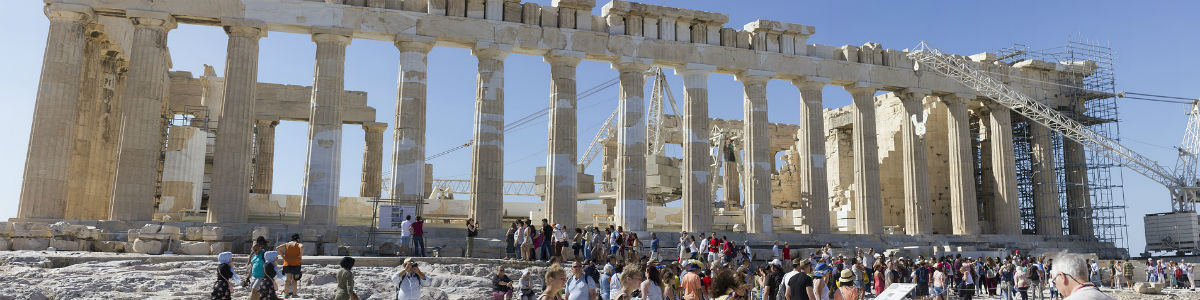 Banner image – an ancient Greek temple with many pillars and no roof.