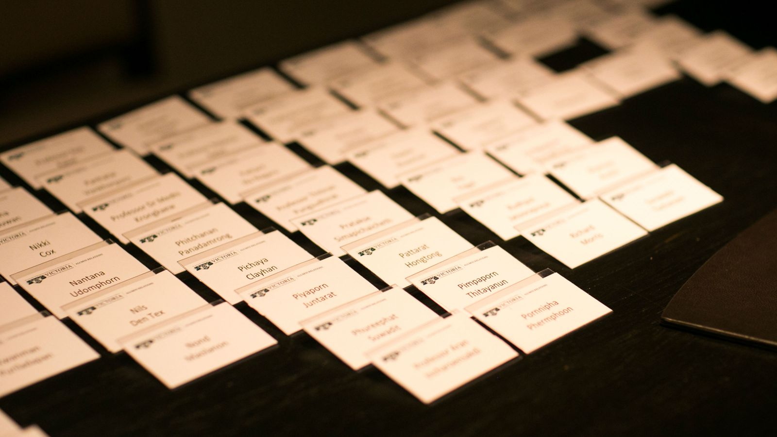 A table with several rows of name tags.