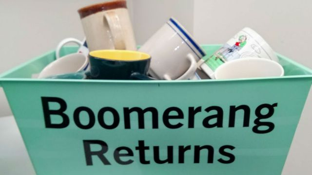 Cups in container with words Boomerang Returns
