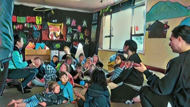 A classroom of children and a teacher playing guitar, whoever a unique filter has been applied making the image look morre like a painting.