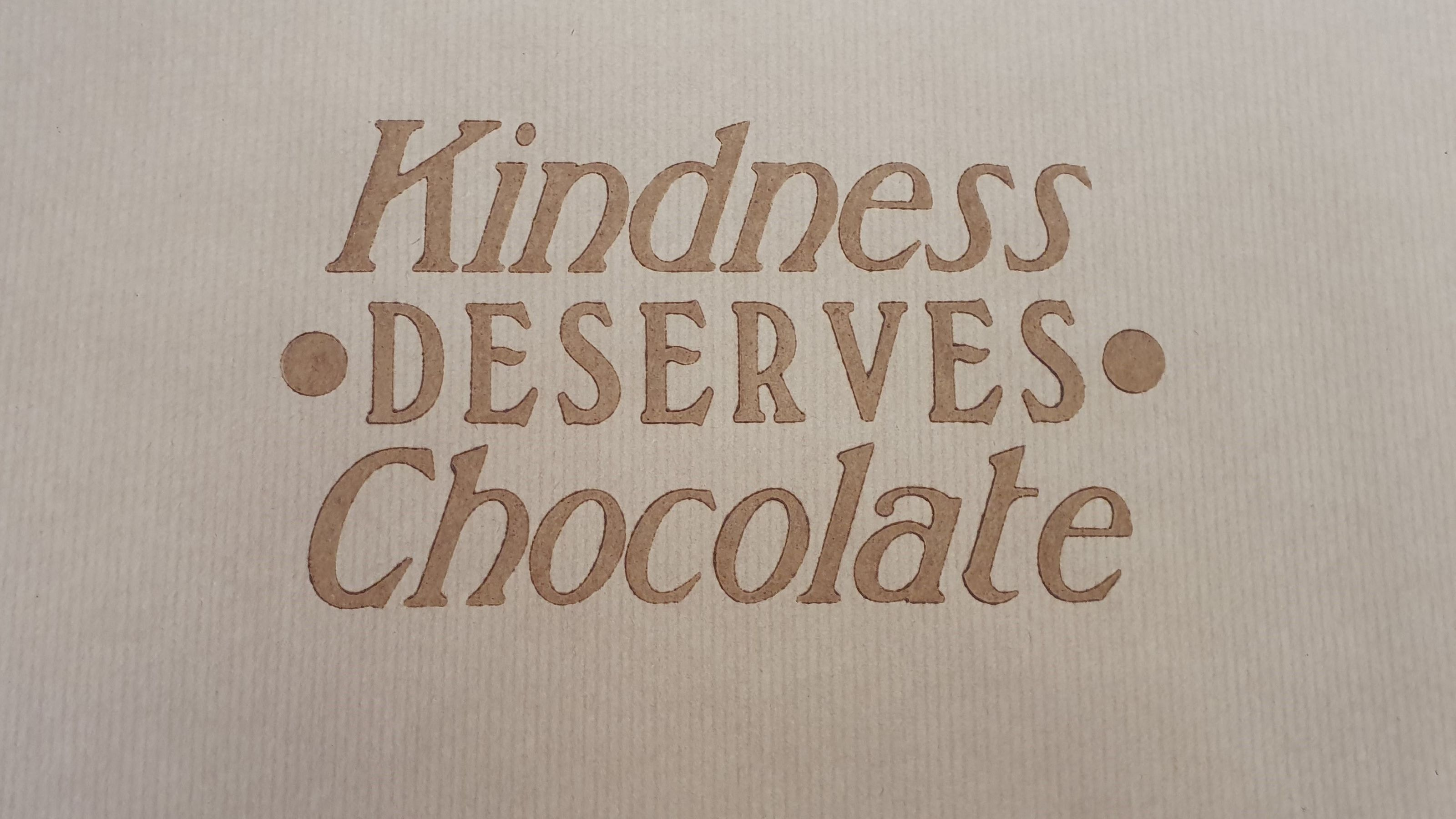 """""""Kindness deserves chocolate"""" printed with chocolate as ink."""