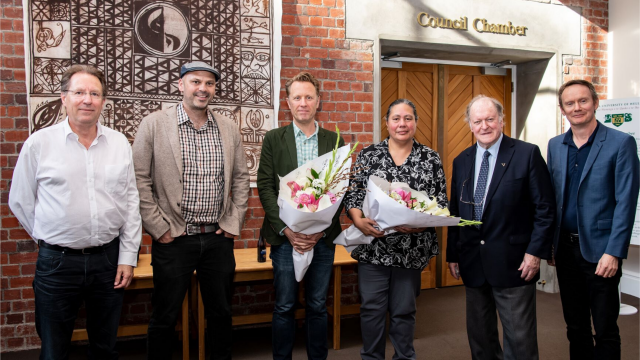 A group stands in front of the Council Chambers – Ken Duncum, Sam Kelly, Jonathan King, Marie Mamea-Crawford, Bill Sheat, Damien Wilkins.