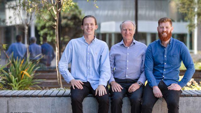 Inhibit Coatings Ltd team pose outside Victoria University of Wellington