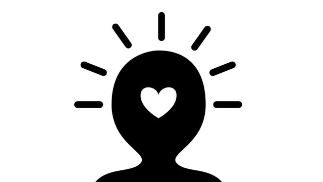 Black animated silhouette of a head and shoulders with a heart in the middle of the head.