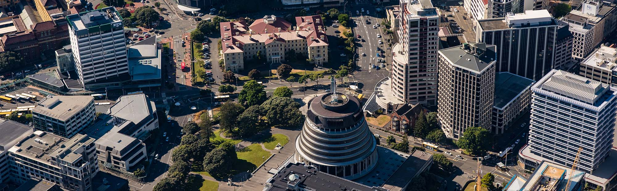 Aerial photo of Wellington's parliamentary precinct featuring Rutherford House and New Zealand's parliamentary grounds.