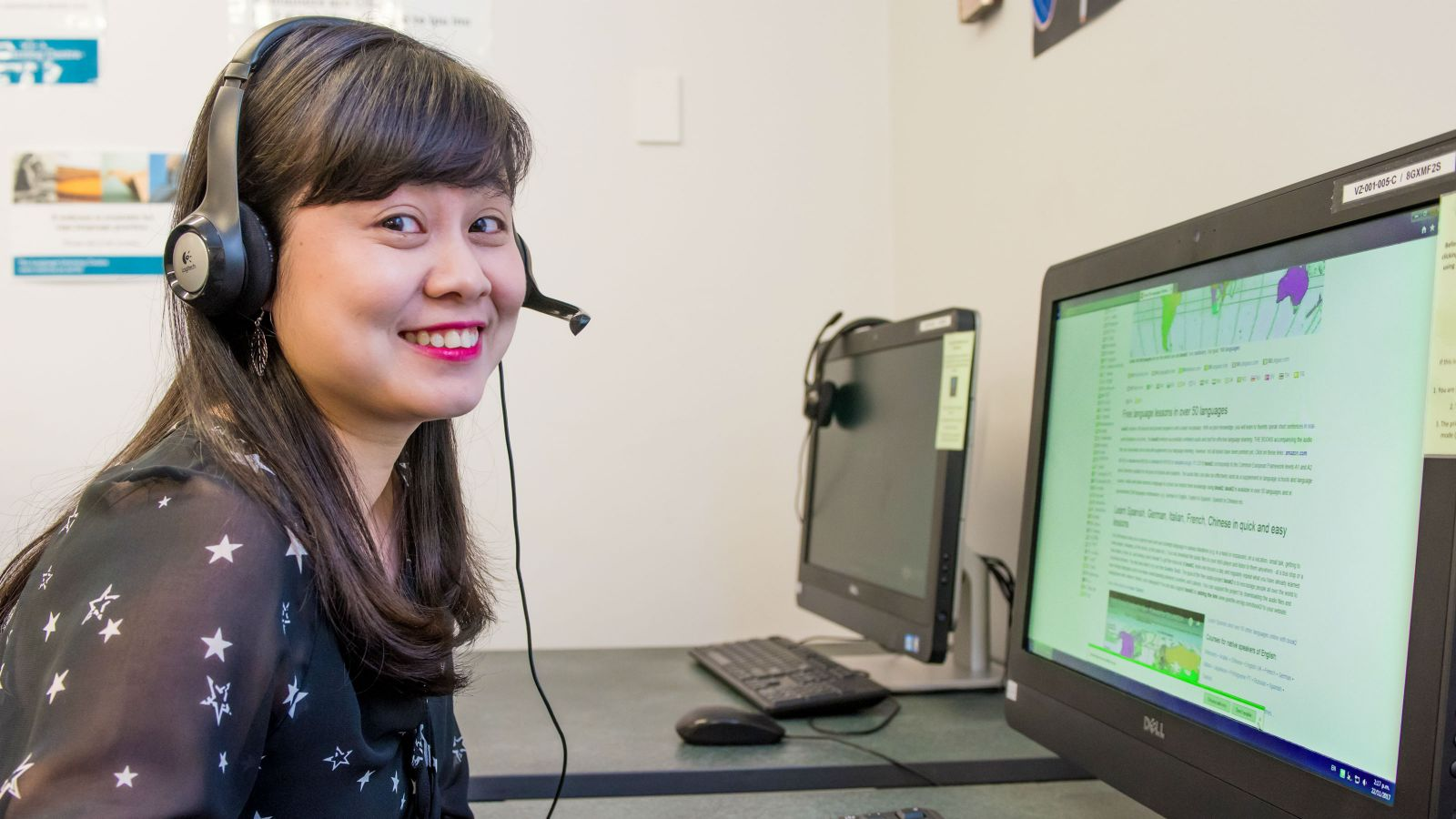 Student with headset practising language online.