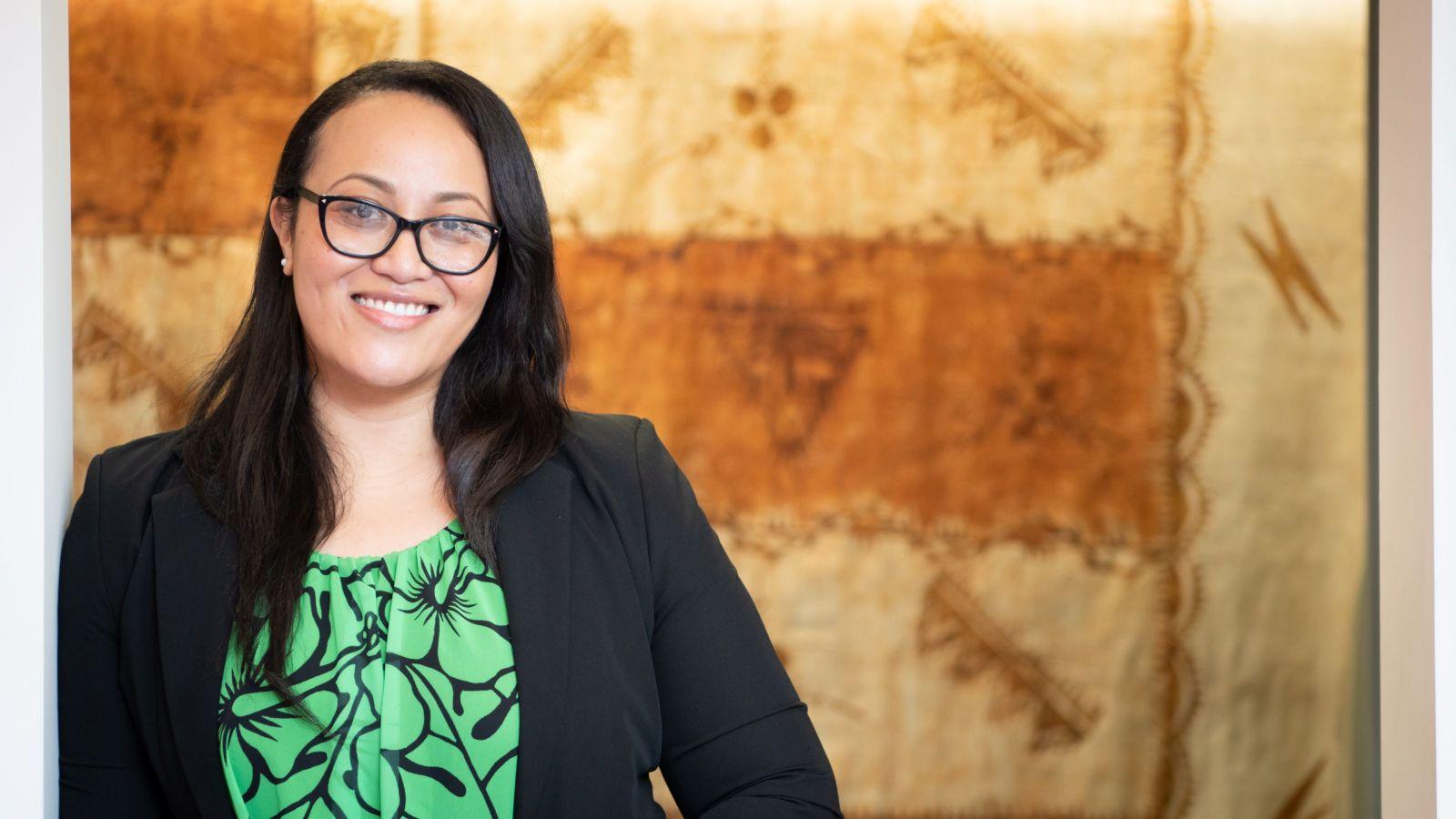 PhD Candidate Linda Fatialofa in front of a Samoan cloth.