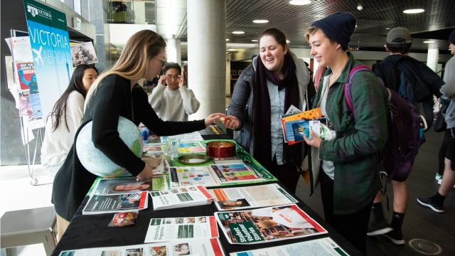 Photograph of a clubs information table in the Kelburn campus Hub