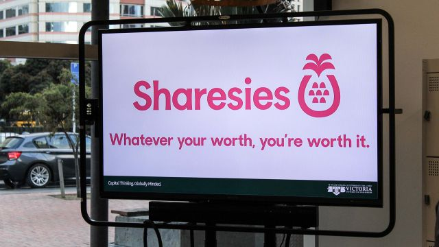 Television screen displaying the Sharesies logo in The Atom Innovation Space.