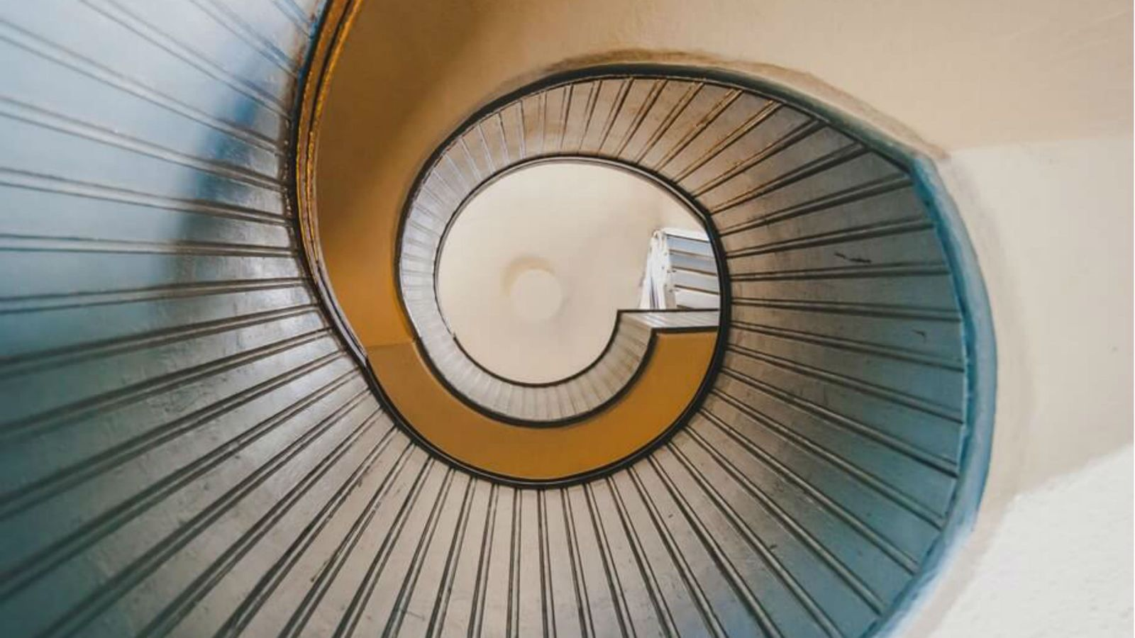 Underside view of a spiral staircase.