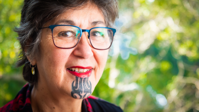 close up of face with te moko Māori tattoo and glasses