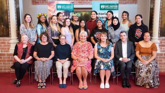 12 scholarship recipients with university staff