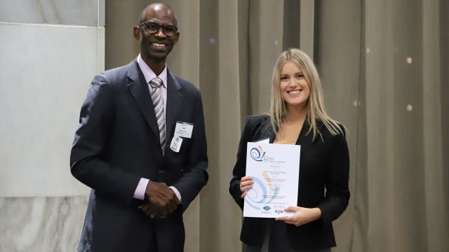 Pro-Vice-Chancellor and Dean of Commerce Professor Ian O Williamson with Bachelor of Commerce student Melanie Davis, who is holding her Champion Team Leader Award