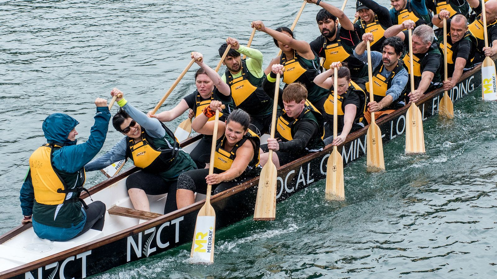 Dragonboat team members racing on Wellington Harbour.