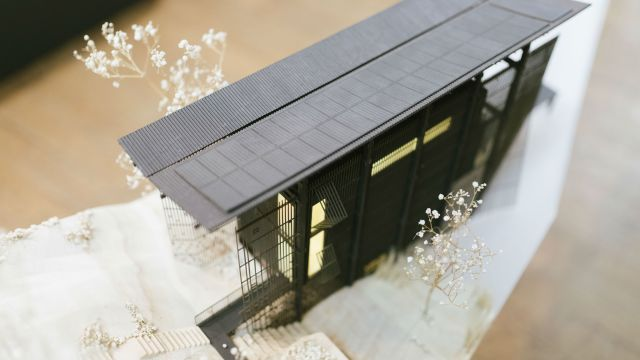 An image showing a model house, the project that won the architecture award.
