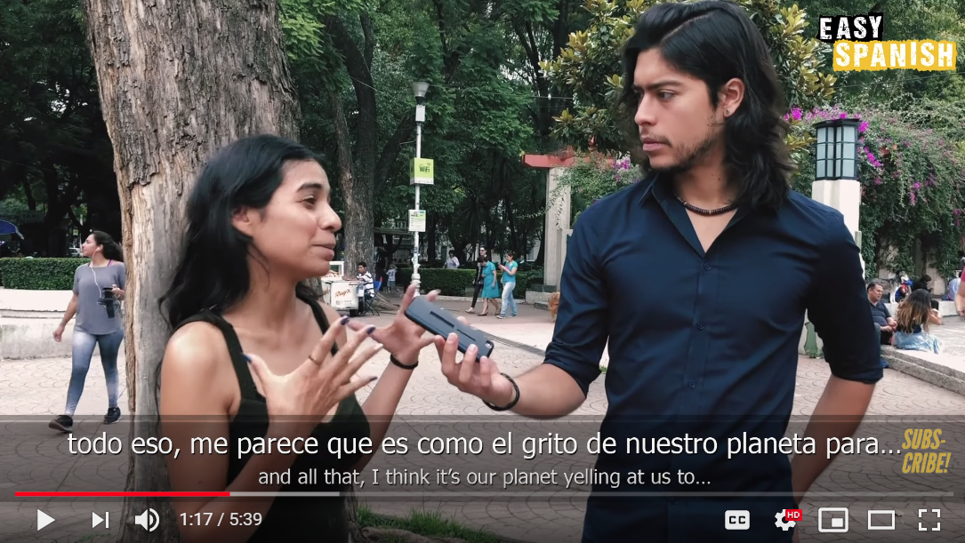 This photo from Easy Spanish YouTube channel shows a young woman being interviewed about climate change.