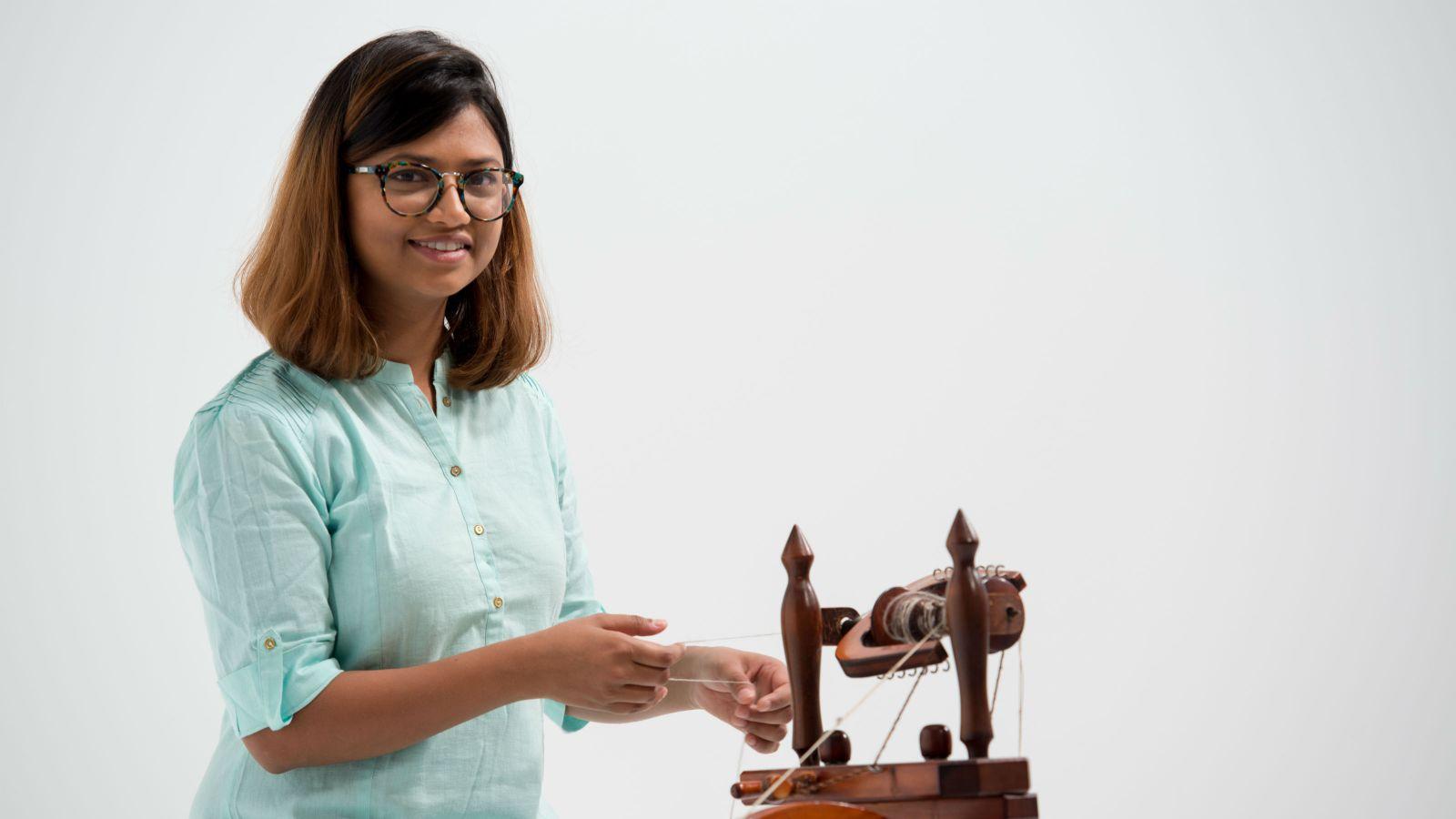 Ananya Khare uses weaving machine