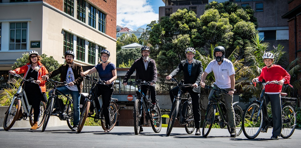 eBike riders pose with ebikes and bike accessories.