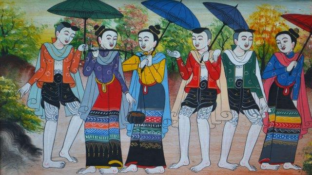 Mural of Burmese people holding parasols.
