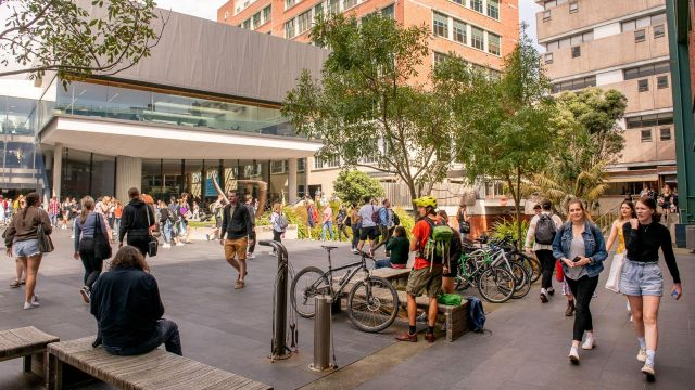 View of Tim Beaglehole courtyard, on Kelburn campus, with students walking