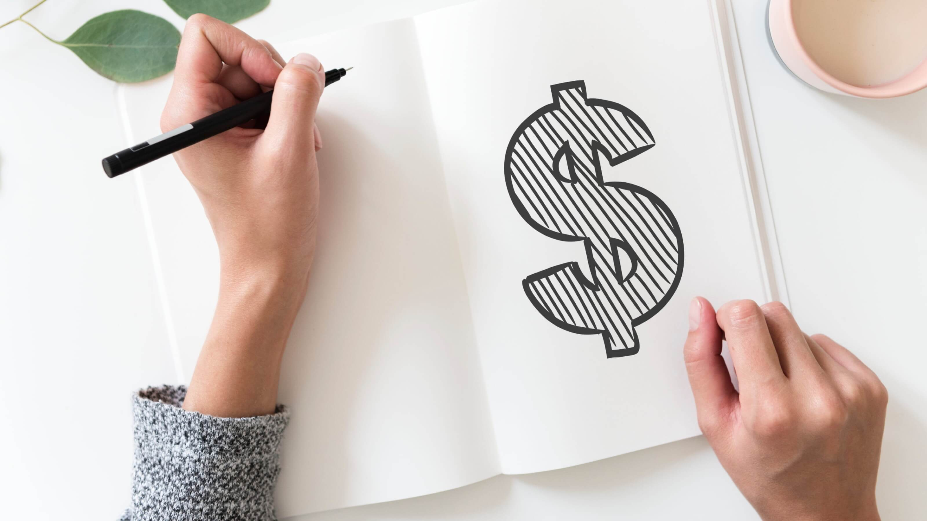 woman sketching a dollar sign