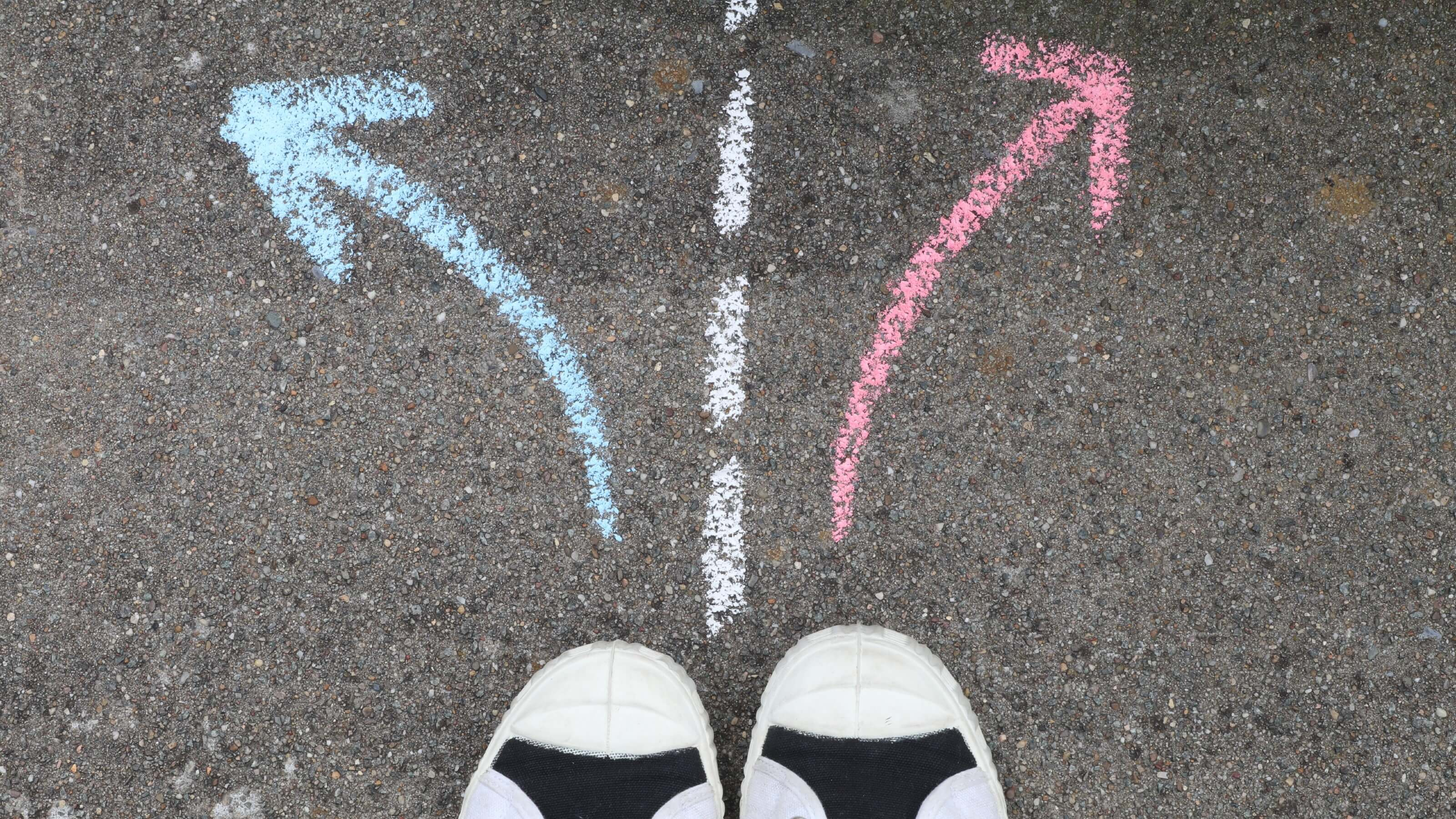 Canvas shoes and coloured arrows pointing to the left and to the right.