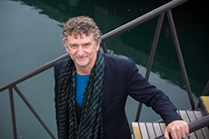 Professor Martin Bryant standing on the jumping platform at Wellington's waterfront
