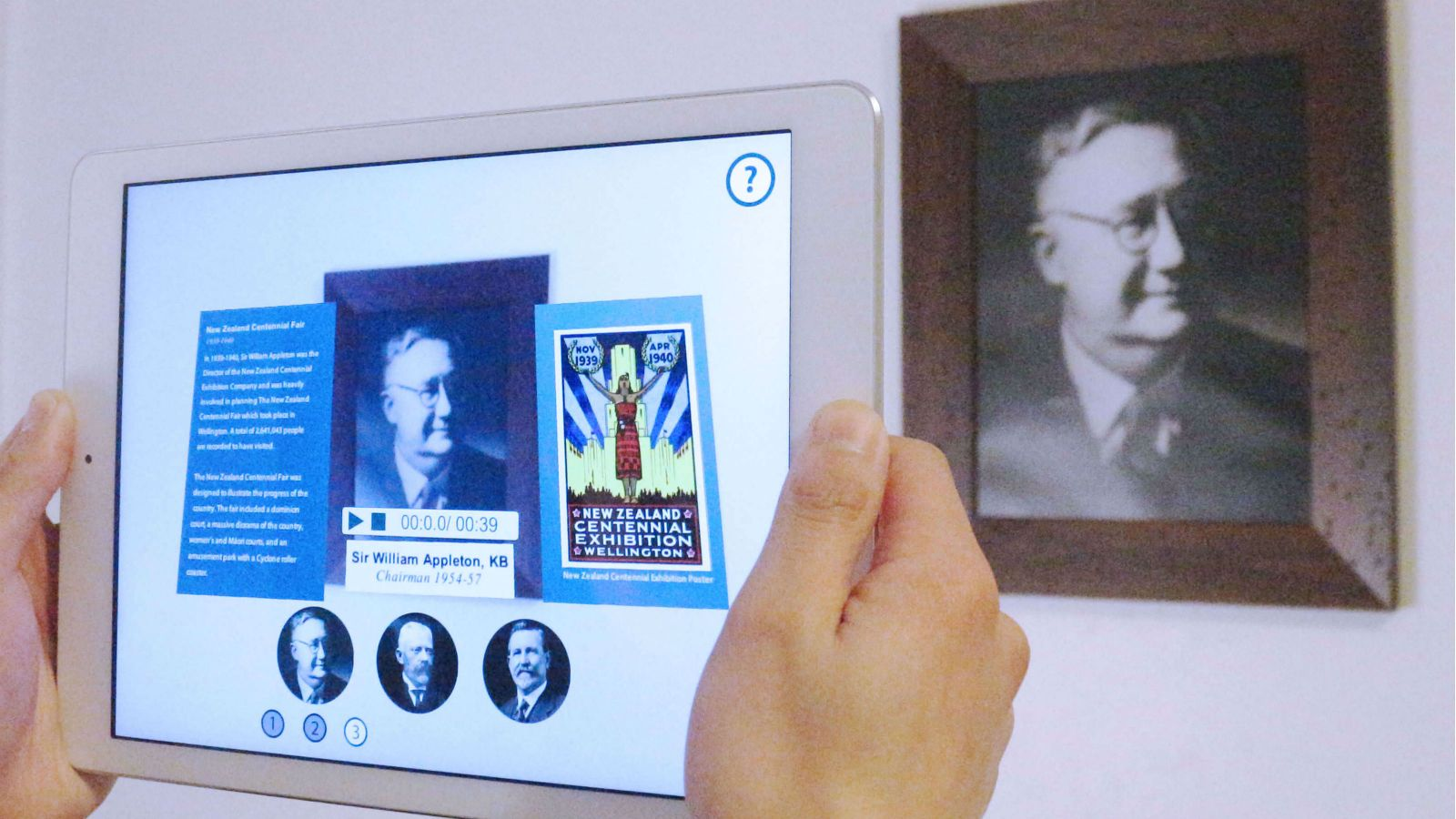An tablet computer photographing a work of art.
