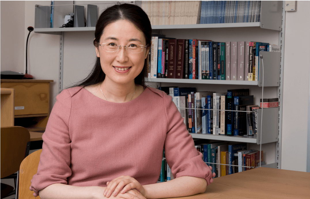 An image of PhD graduate, Dr Honghong Zhang in an office.