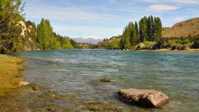 View of a clear freshwater lake or river on a sunny day in the south island of New Zealand
